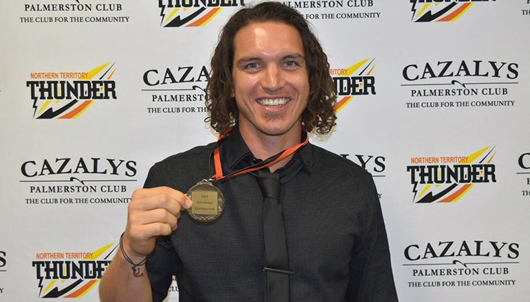 Cam Ilett with the medal in his own name