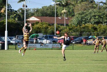 Hugo kicks a goal