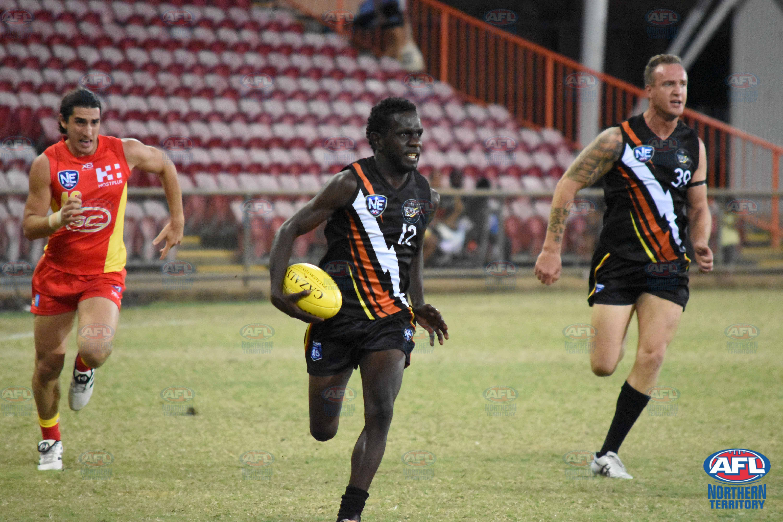 Dion Munkara with the ball