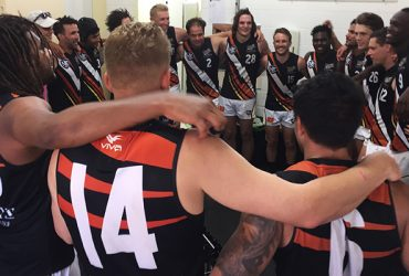 NT Thunder sing the song after a win