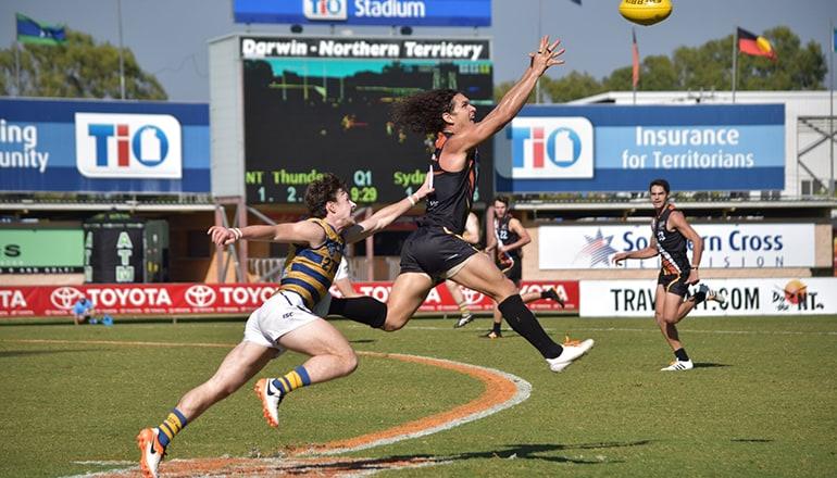 Ilett leaps to mark the ball against Sydney Uni
