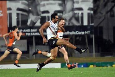 Richard Tambling runs through the middle