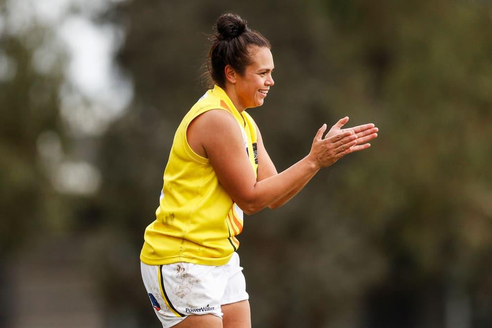 Lauren Motlop claps a team effort