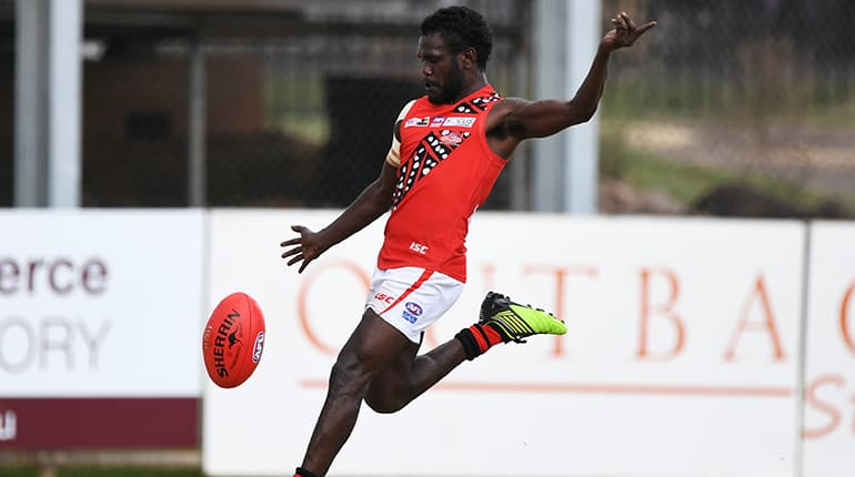 Adam Tipungwuti in action for the Tiwi Bombers