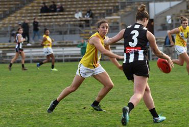 Angela Foley tries to stop Collingwood
