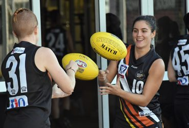 Amy Chittick handballs during training