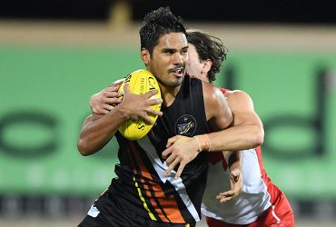 Daniel Weetra in action against Sydney Swans