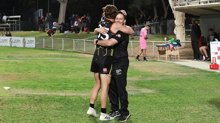 Darren Reeves celebrates with Dylan McLachlan